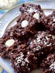 Chocolate Oatmeal cookies piled up on a plate.