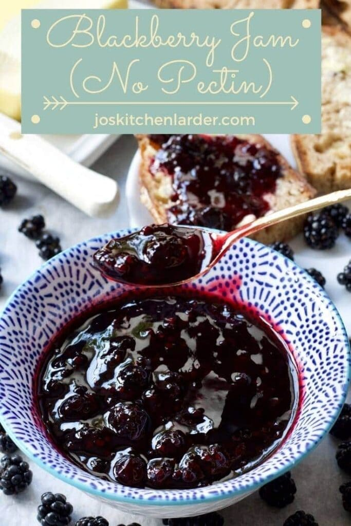 Spoonful of blackberry jam over a bowl filled with jam.