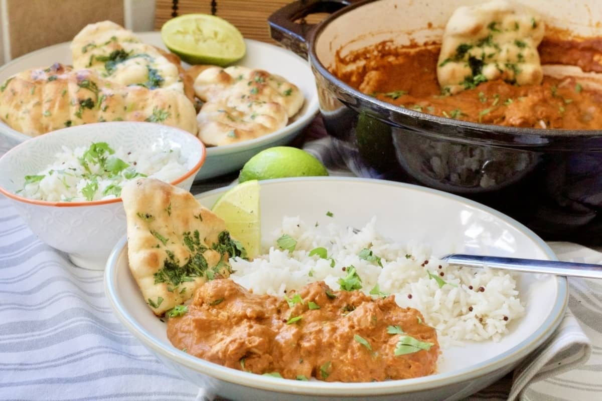 Curry spread with bowl full of easy naan bread in the background.
