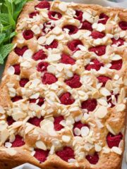 Whole raspberry cake with fresh mint & flaked almonds.