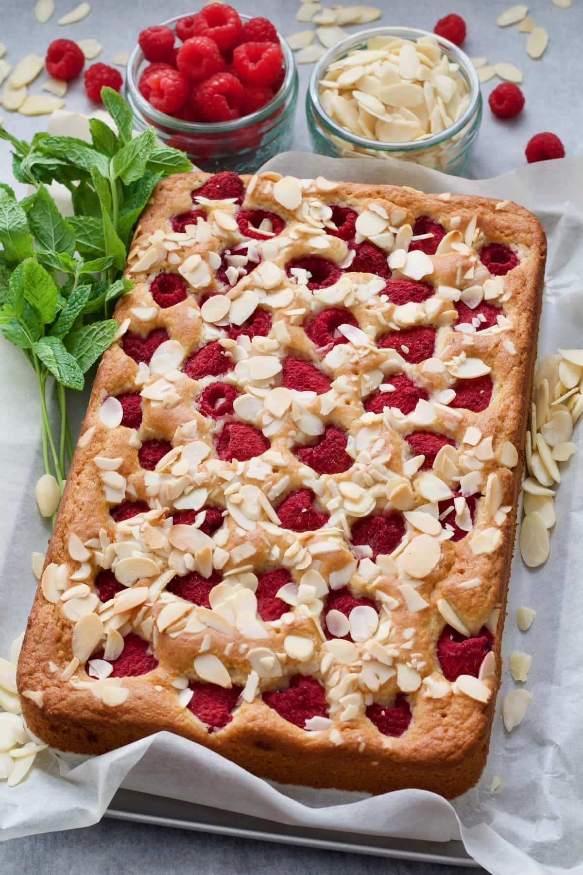 Whole raspberry cake with mint, fresh raspberries & flaked almonds.
