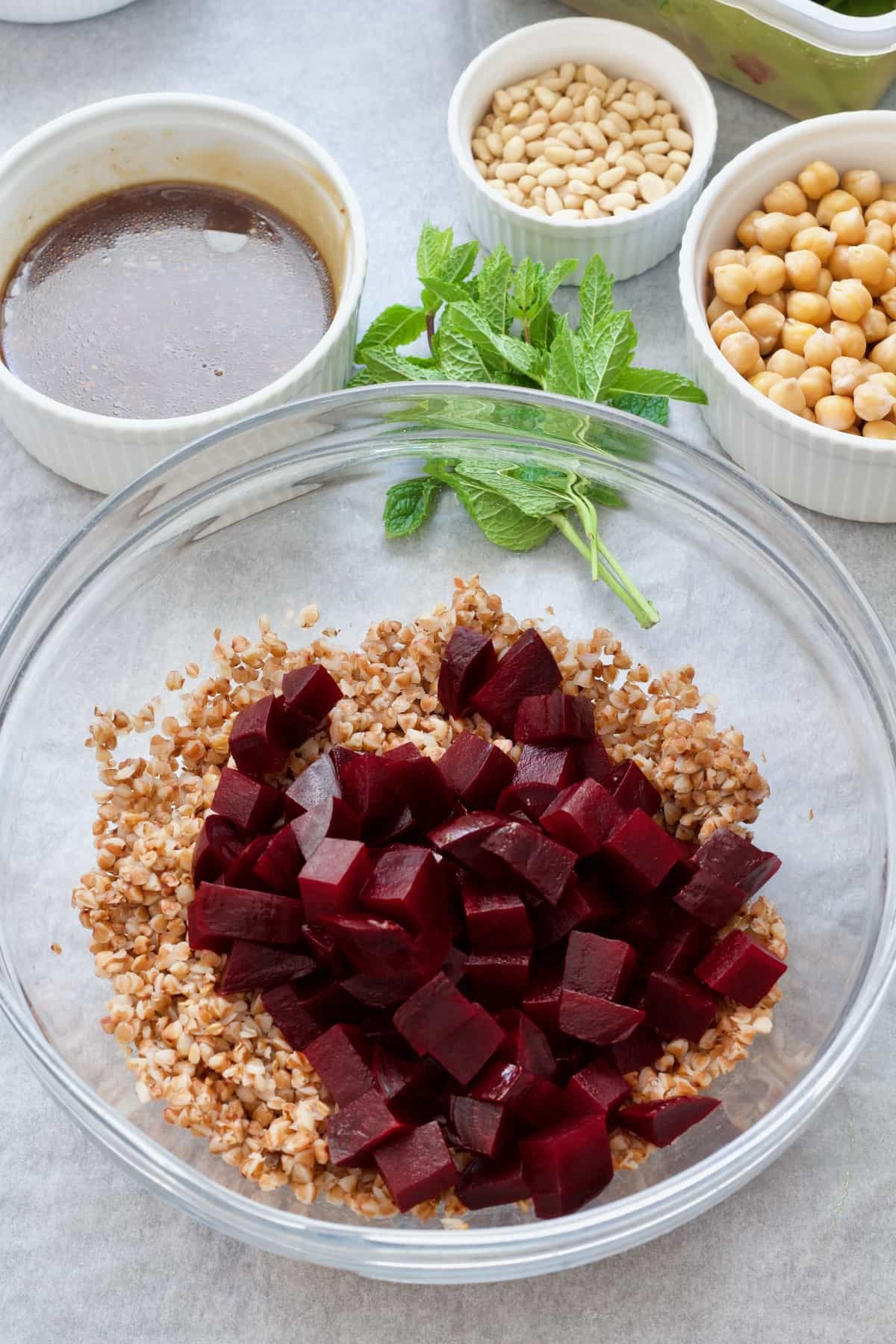 Bowl with buckwheat and cubed beetroot.