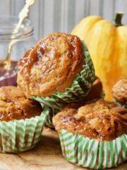 Close up of vegan pumpkin muffins glazed with plum jam.