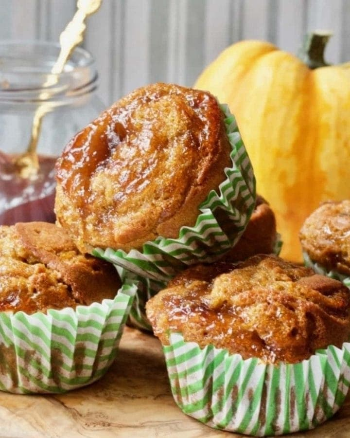 Close up of vegan pumpkin muffins glazed with plum jam.