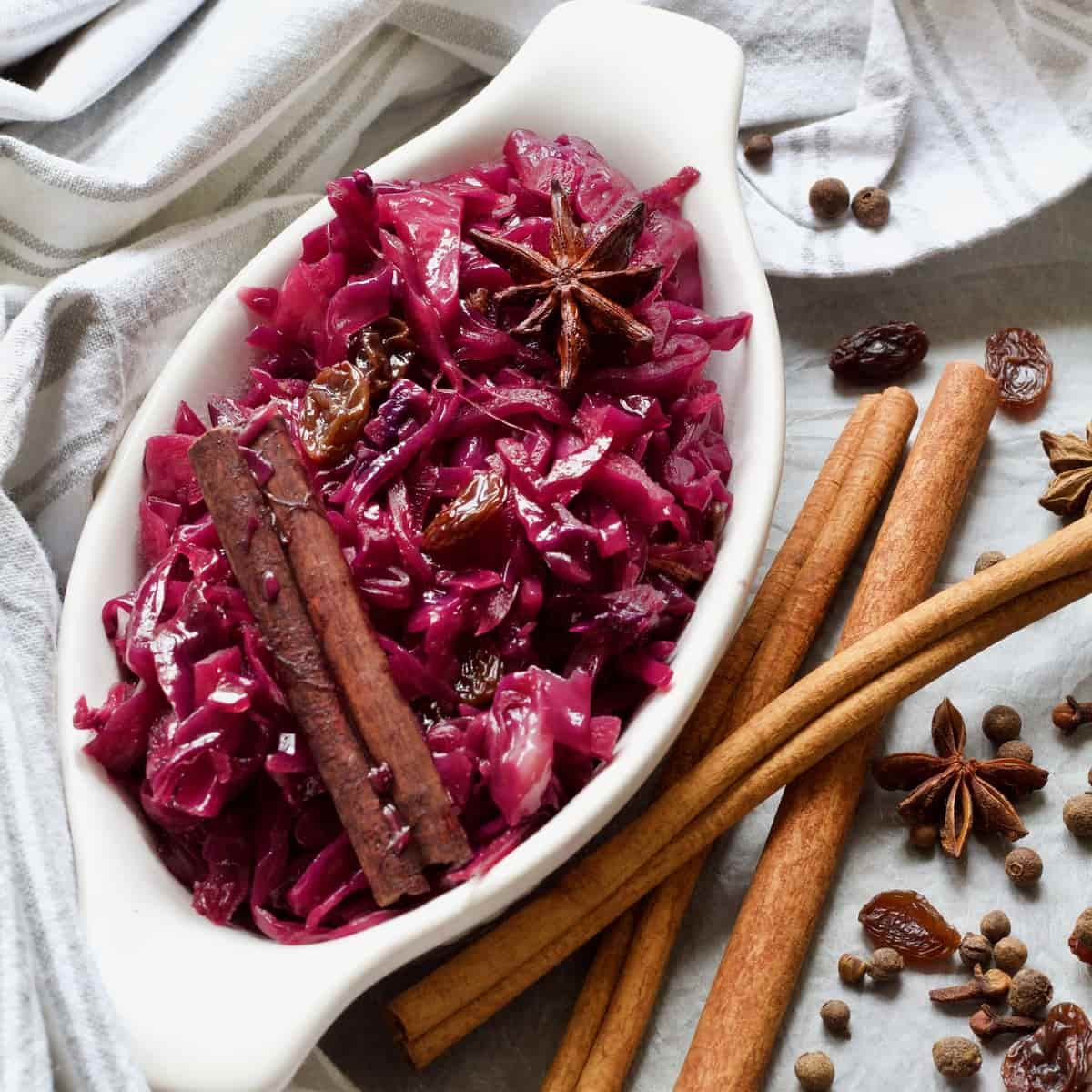 Oval dish with red braised cabbage, raisins and spices.