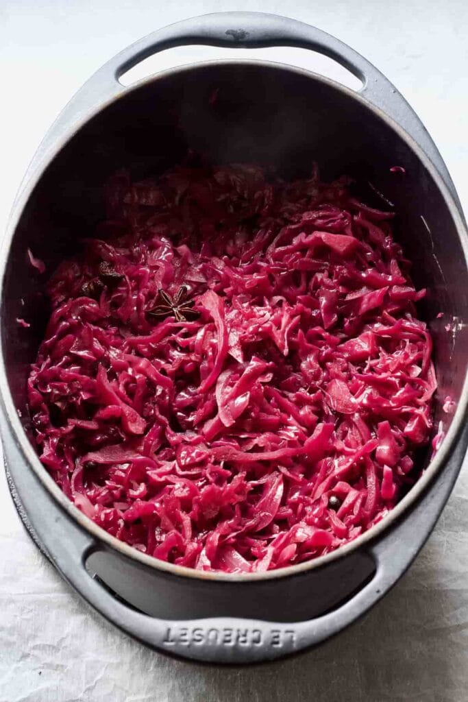 Black oval pot with braised red cabbage.