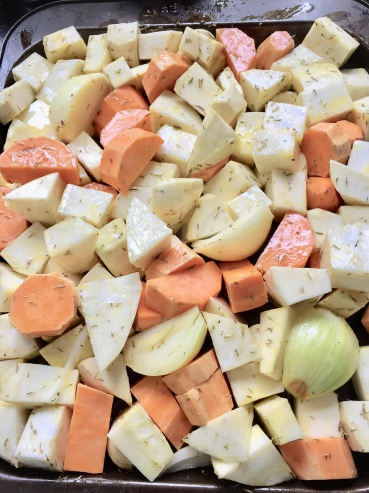 Vegetable chunks on a baking tray.