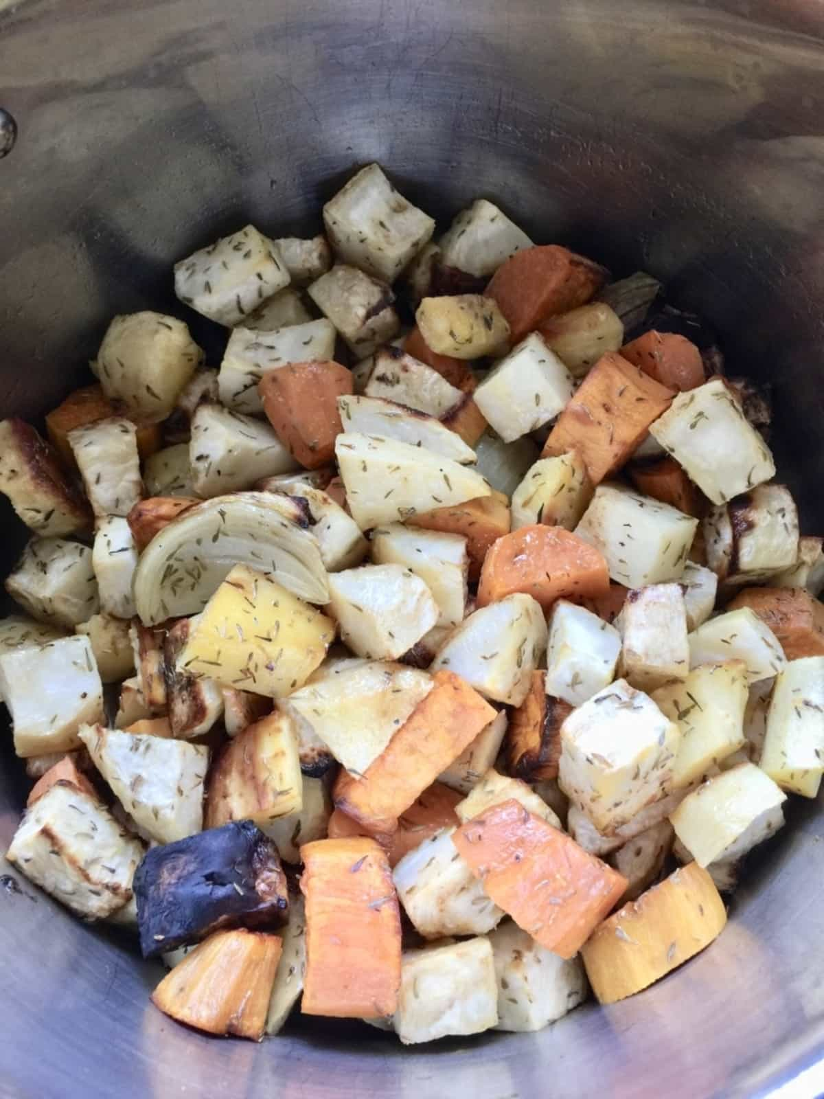 Roasted vegetable chunks in a pot.