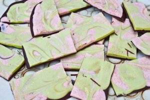 Chocolate bark pieces green and pink.