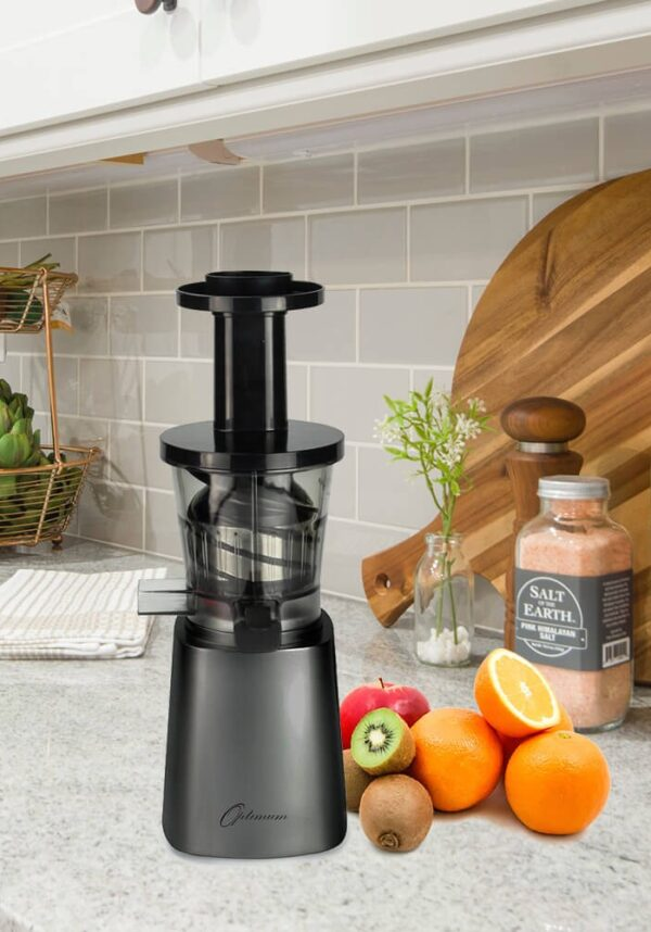 Black juicer on a kitchen counter.