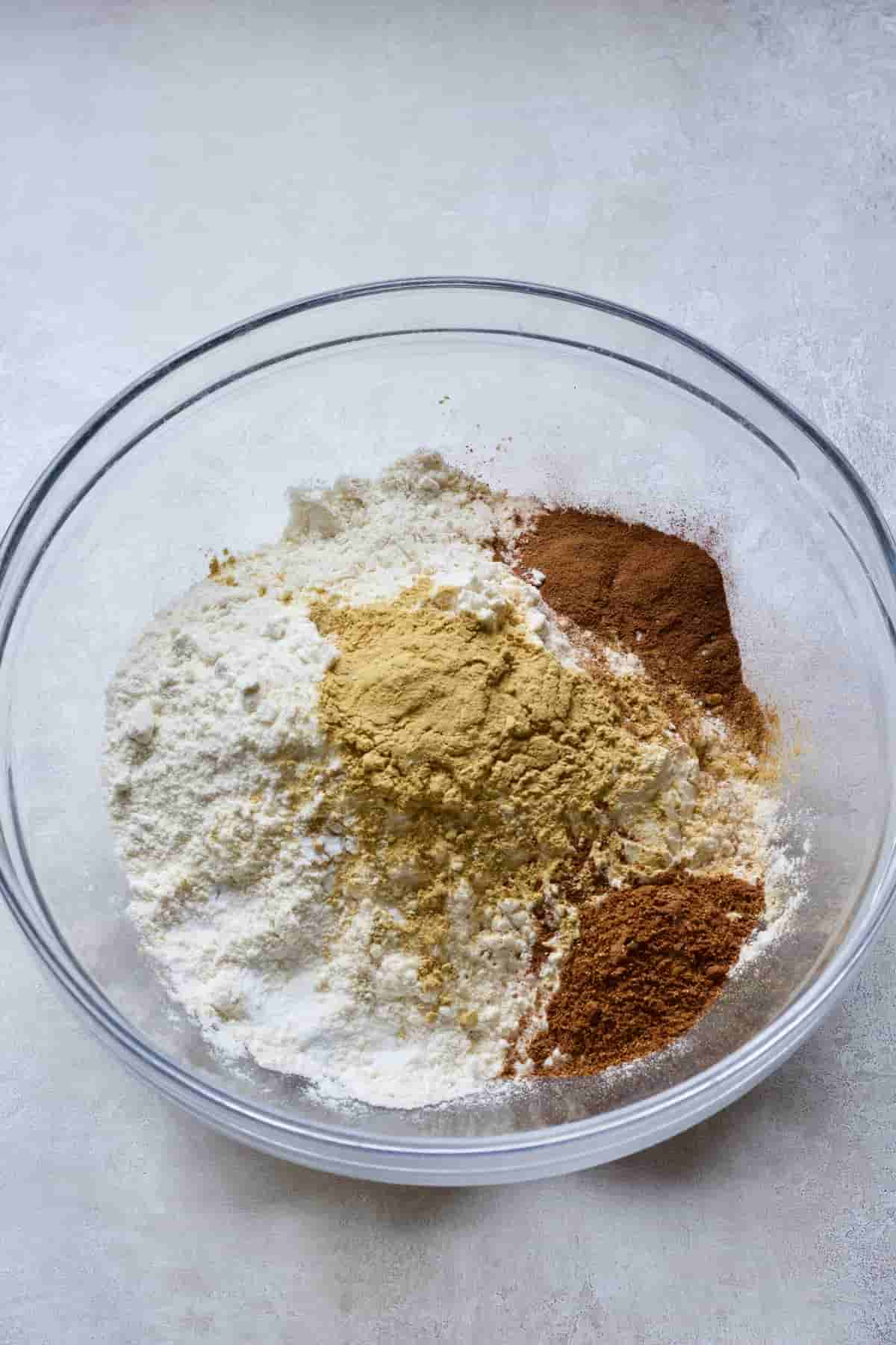 Flour and spices in a glass bowl.