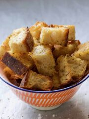 Small bowl full of croutons.