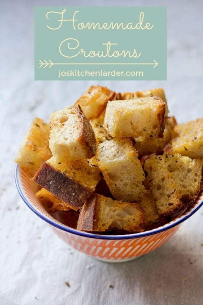 Bowl filled with homemade croutons.
