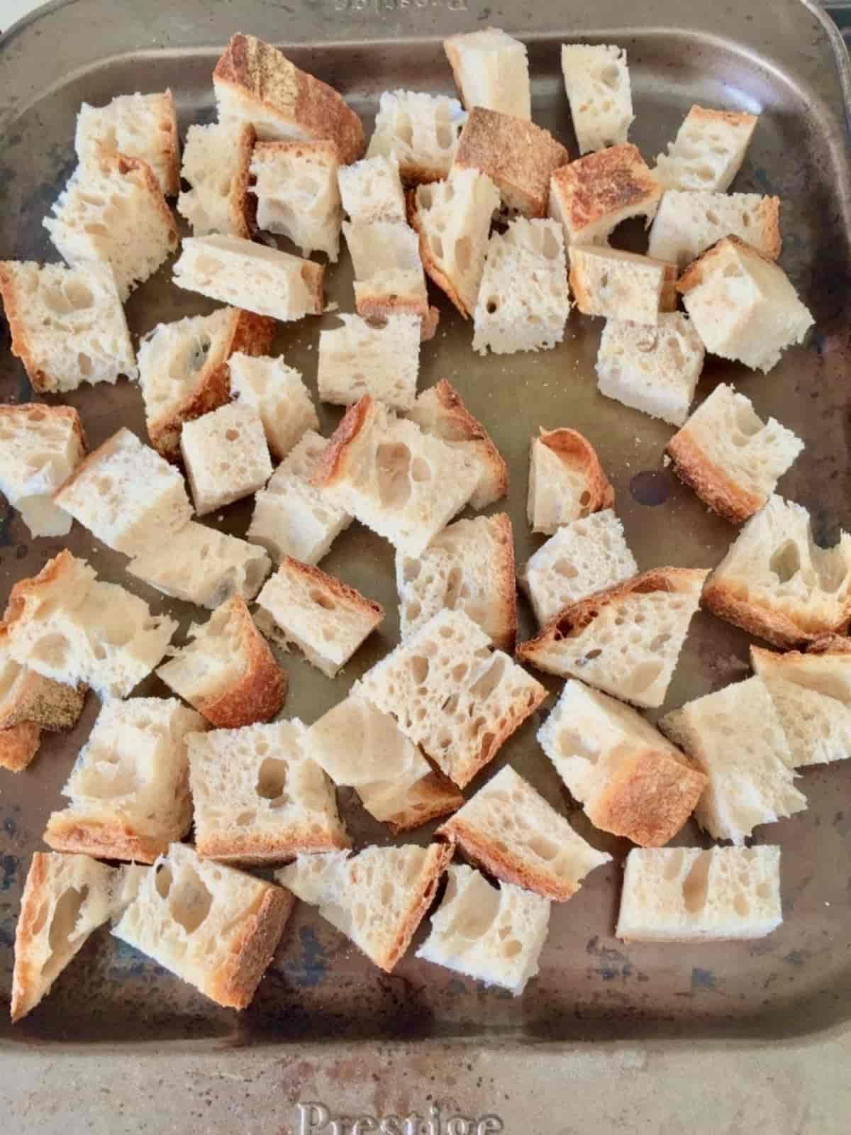 Plain chunks of bread on a baking tray.
