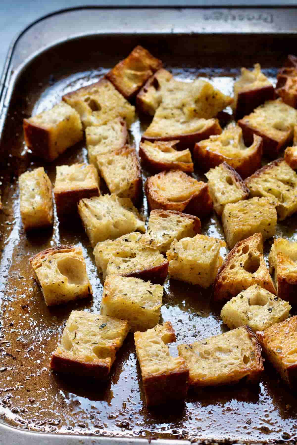 Croutons on a baking tray.