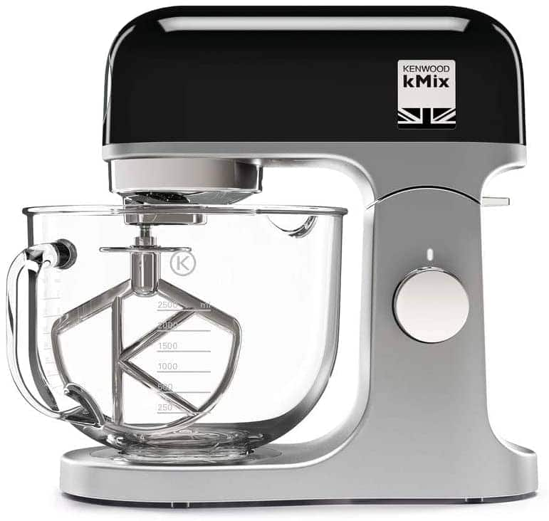 Black stand mixer with glass bowl.