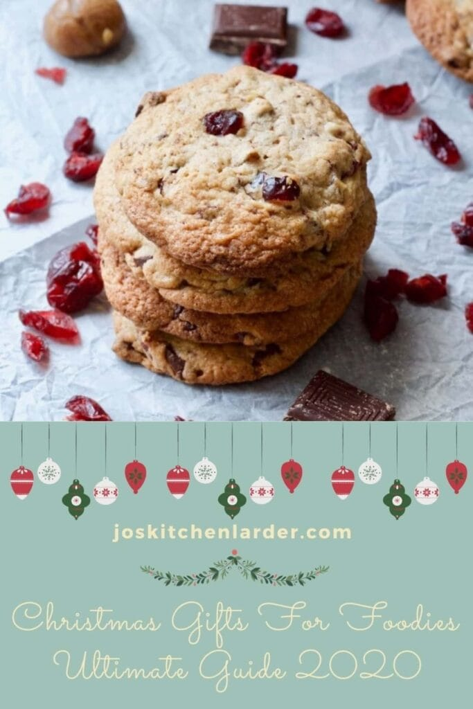 Stack of cookies with cranberries and chocolate.
