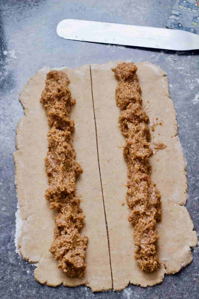Fig filling on top of the pastry ready for rolling.