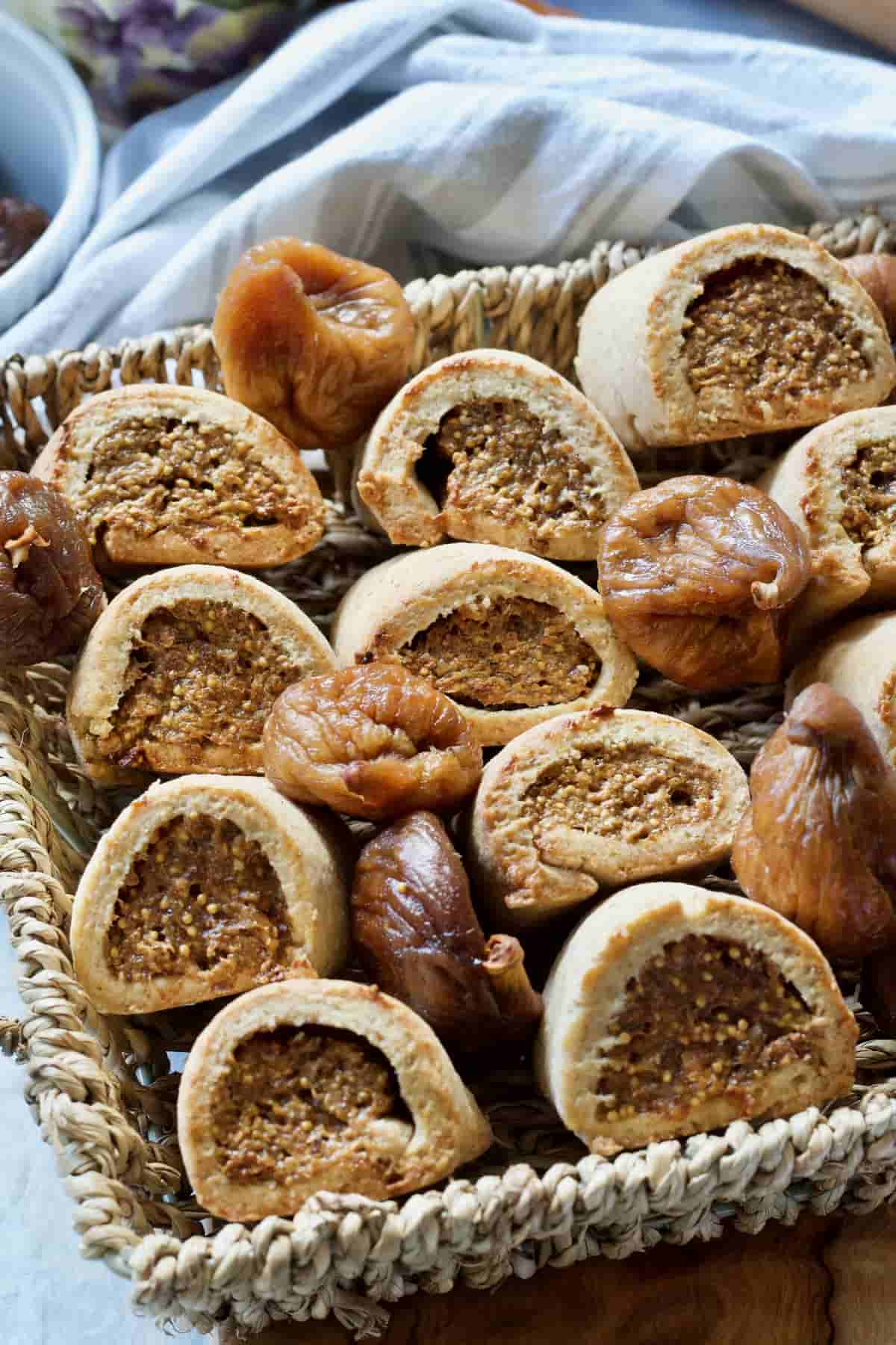 Wicker basket with homemade fig rolls and dried figs.