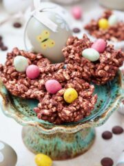 Easter Chocolate Nests on a mini cake stand with an Easter egg.