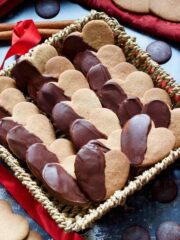 Chocolate covered cinnamon cookies in a basket.