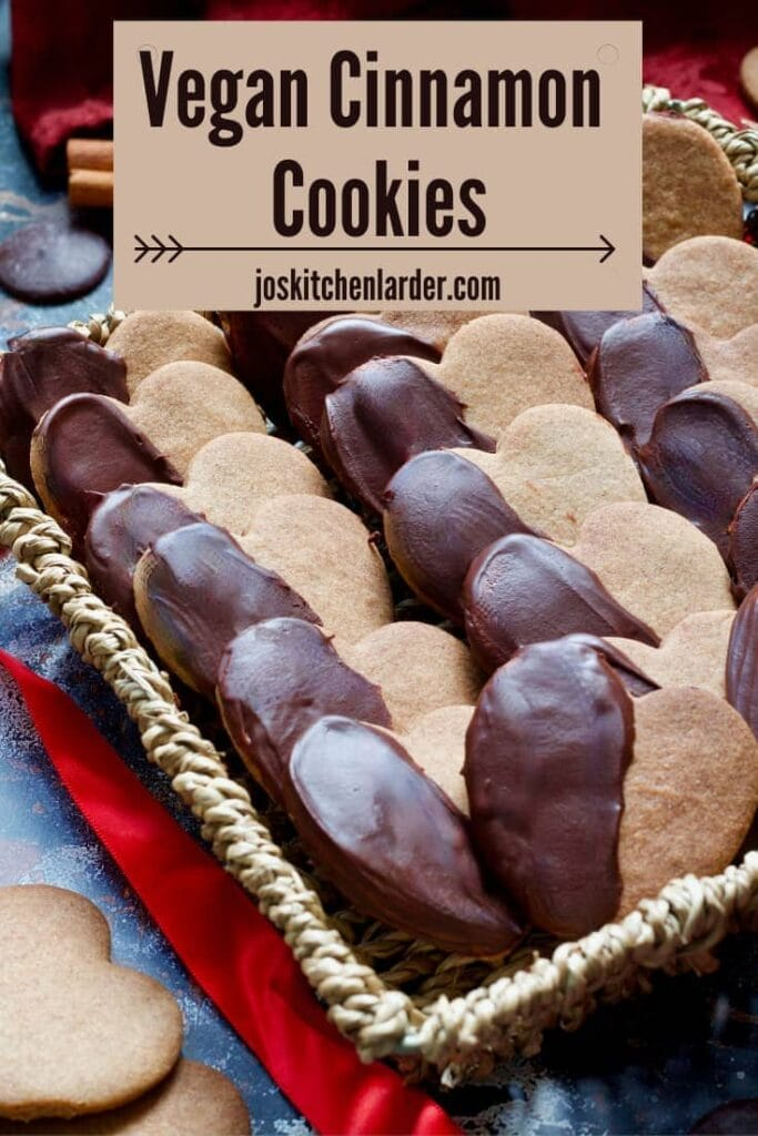 Chocolate covered cinnamon cookies in a basket (pin).