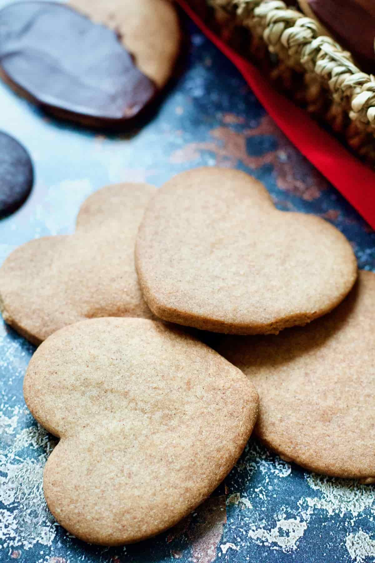 Hear shaped cinnamon cookies piled up (close up).
