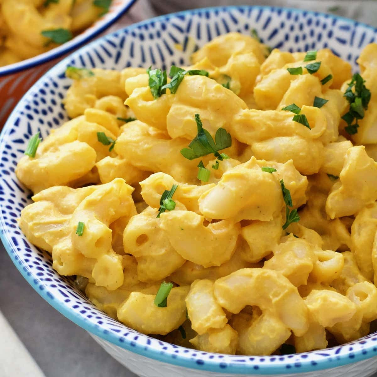 Small bowl with creamy vegan butternut squash mac and cheese.