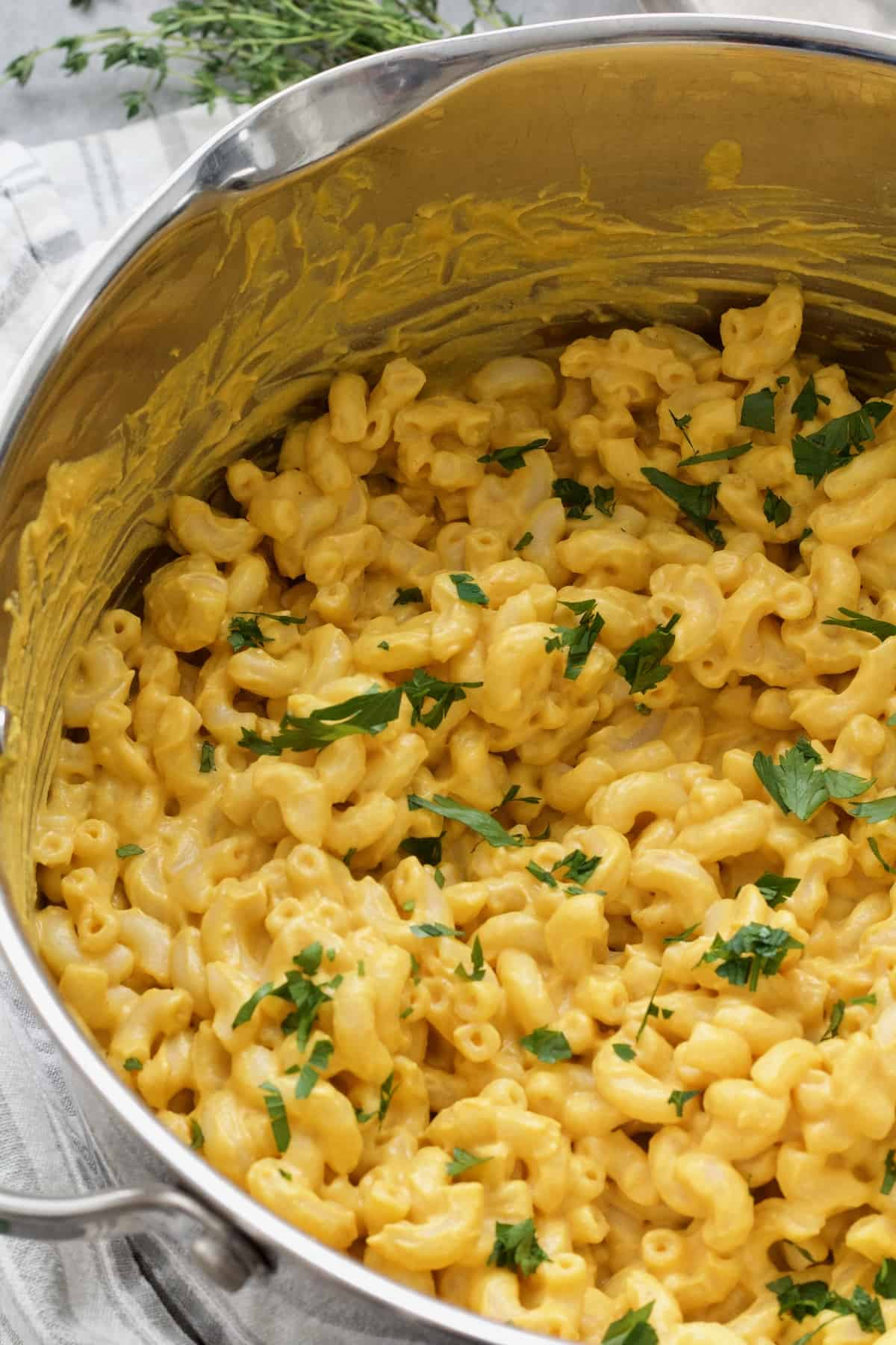 Close-up of pot with vegan butternut squash mac and cheese.
