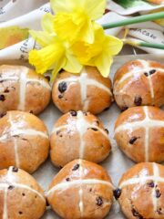 Hot cross buns with daffodils at the top.