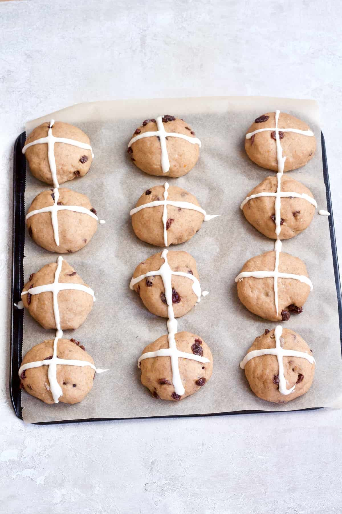 Buns with crosses on ready for the oven.
