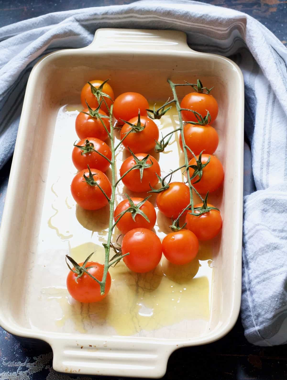 Cherry tomatoes in a baking dish.