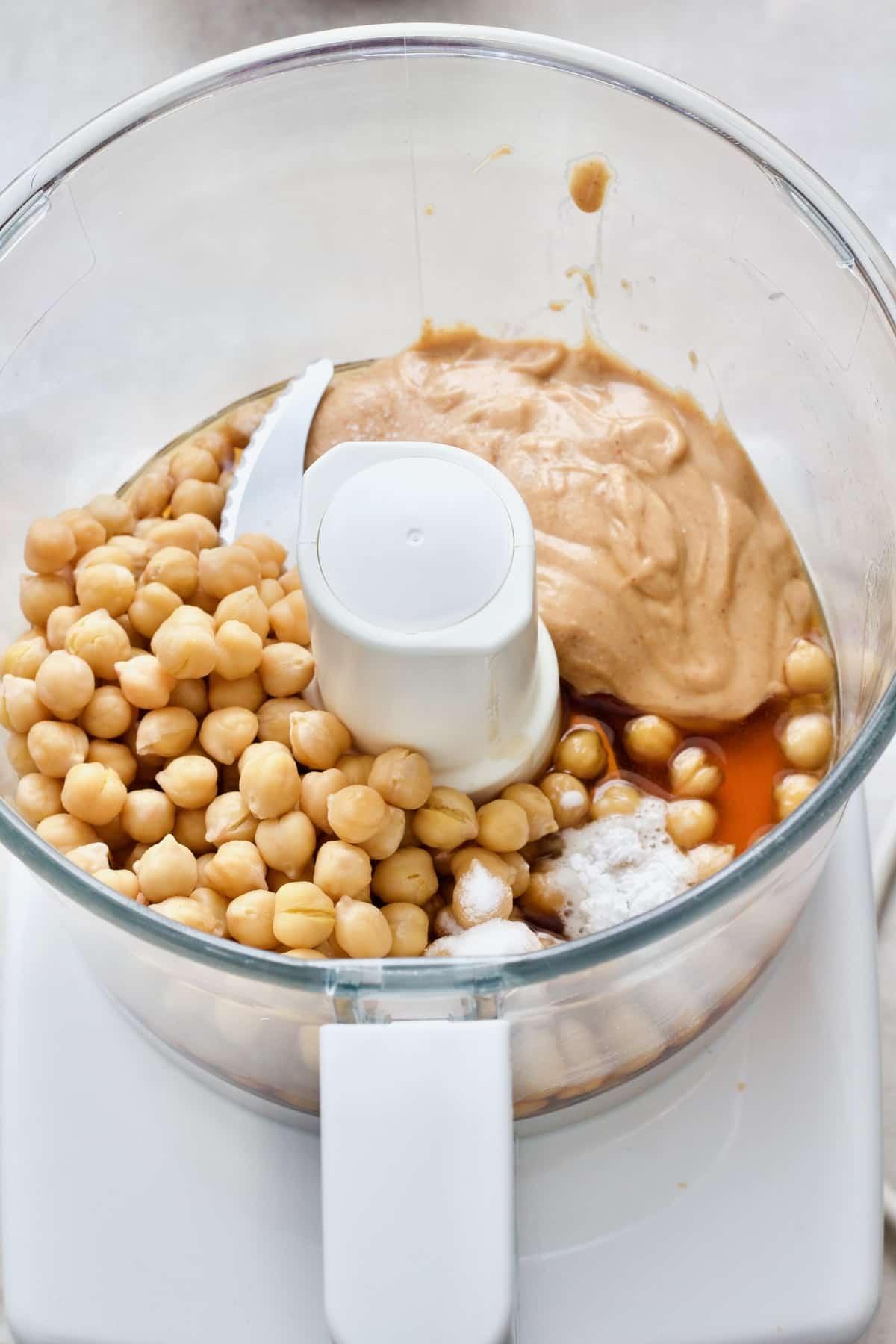 Vegan blondies ingredients in food processor.