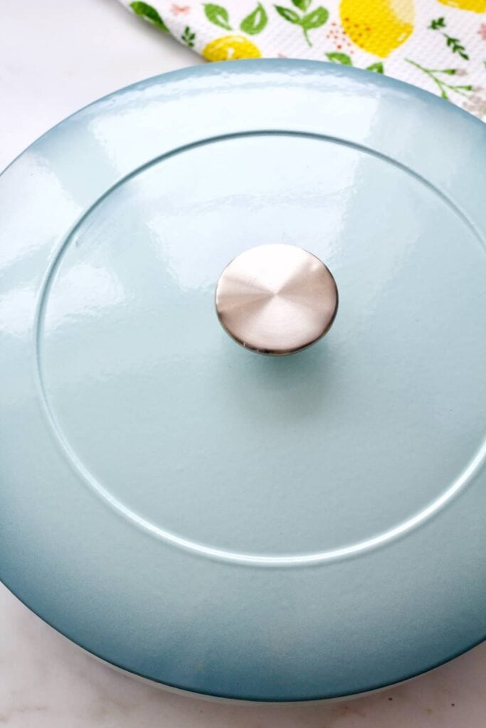Light blue pan with a lid on.