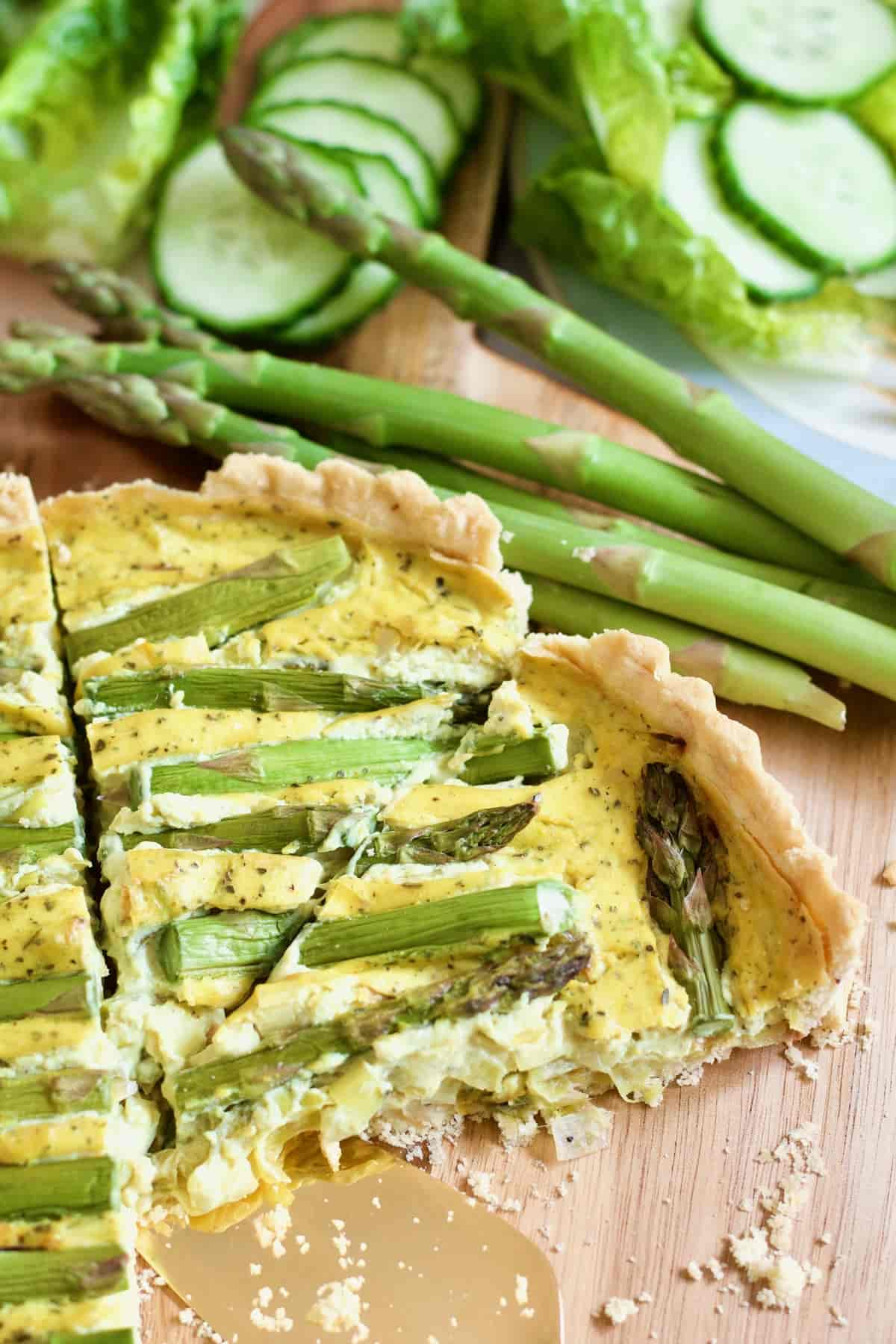 Two slices of vegan quiche on a board.
