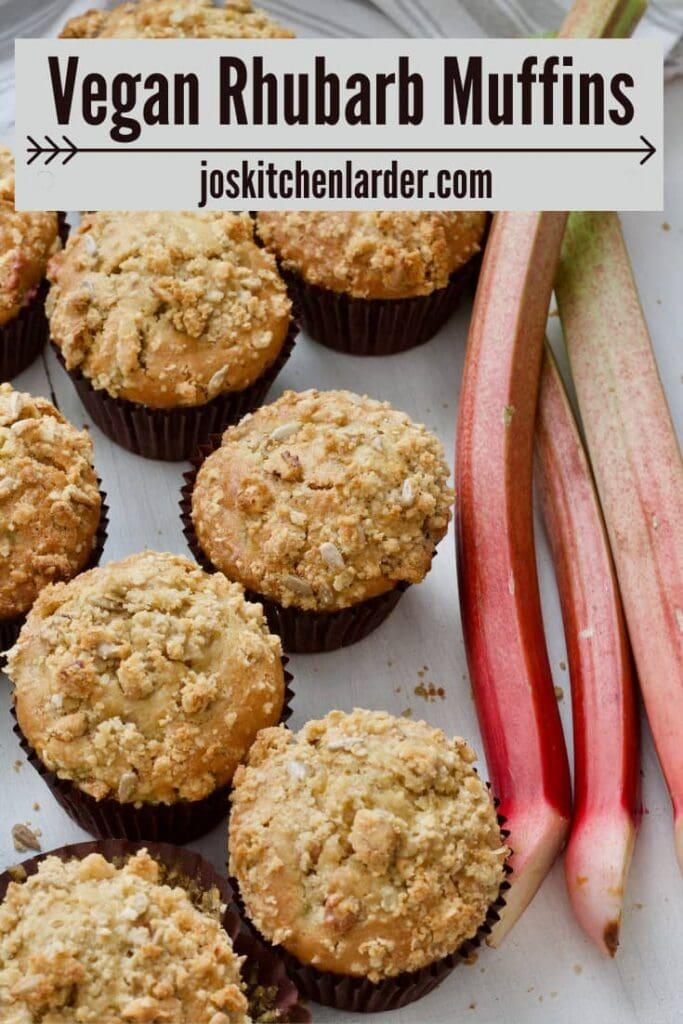 Rhubarb muffins w with rhubarb stalks alongside them.