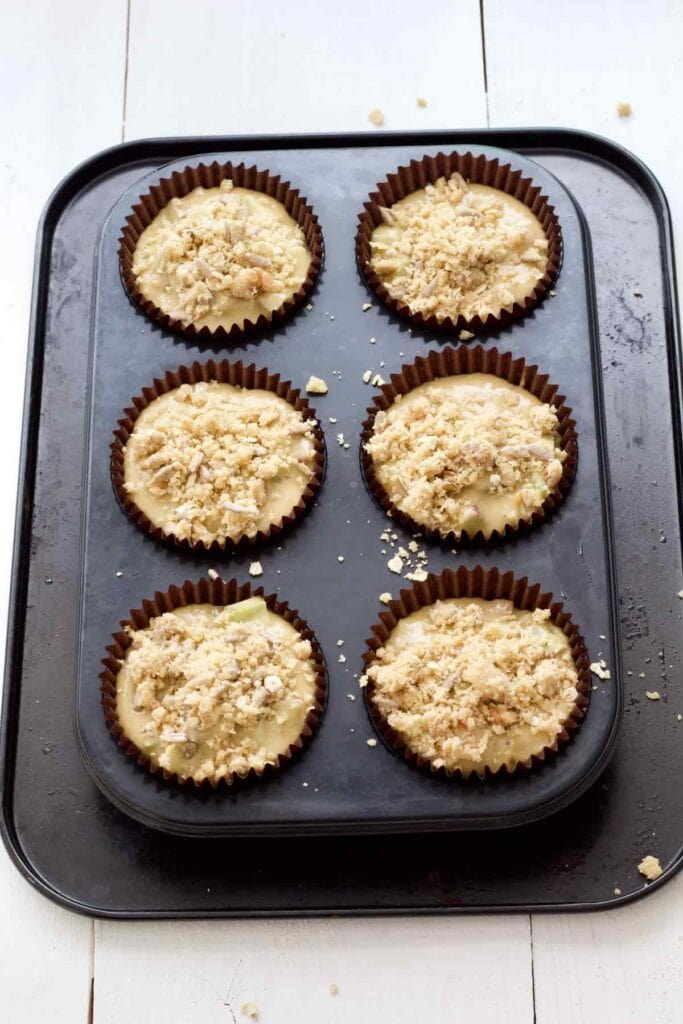 Rhubarb muffins in cases ready for the oven.