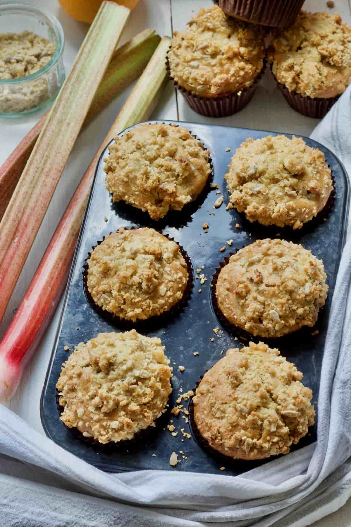 Baked rhubarb muffins still in a muffin tin.