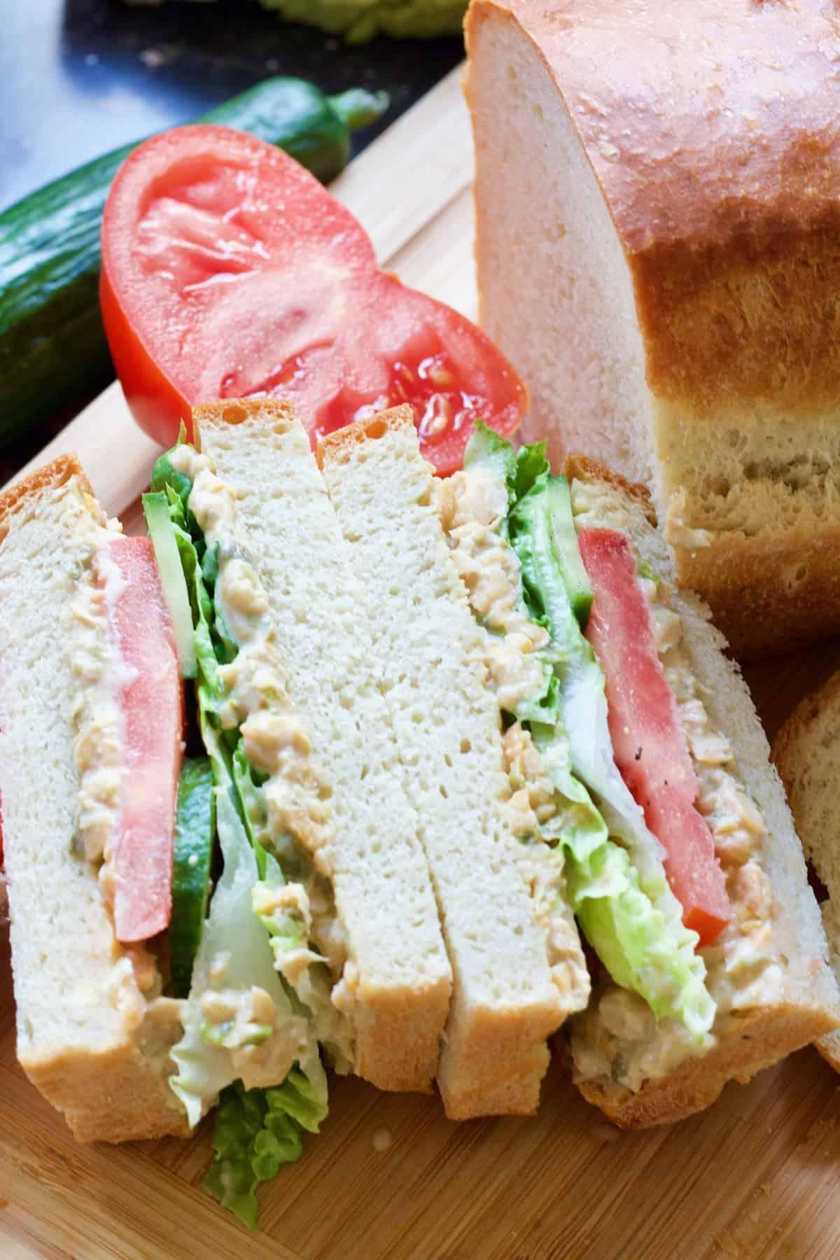 White bread sandwich shown cut in half.