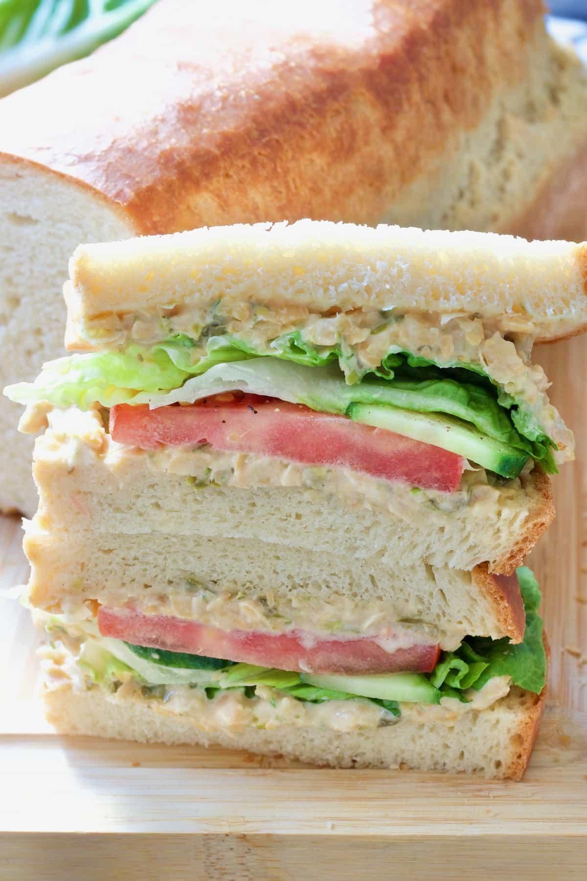 White bread sandwich halves piled up.