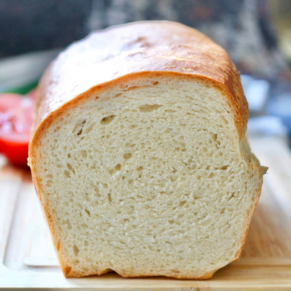 Close up of cut white bread loaf showing off its crumb.