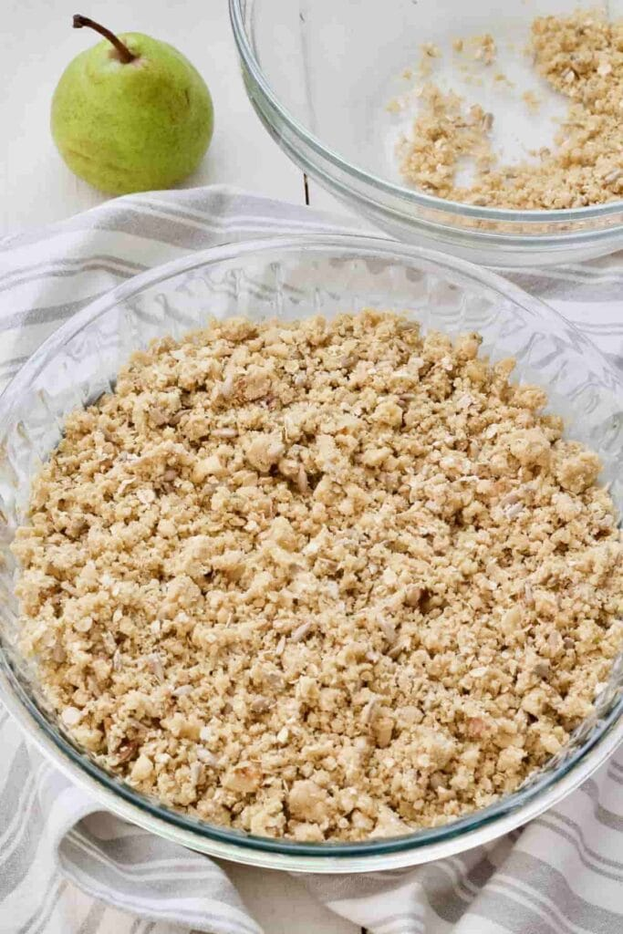 Assembled pear crumble before baking.