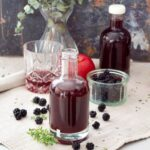 Blackberry vinegar, blackberries, tumbler, apple, vase.