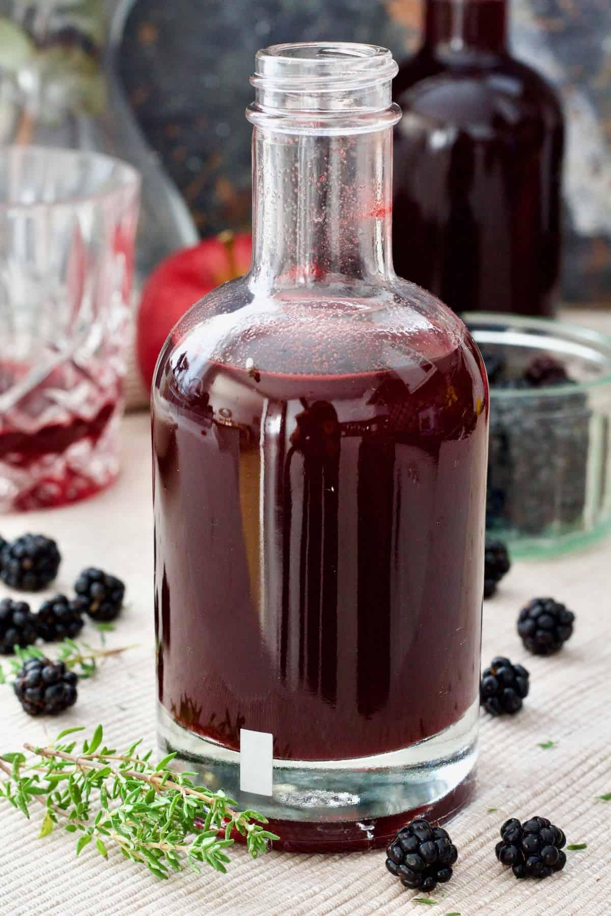Close up of bottle with blackberry vinegar.