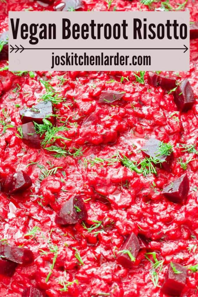 Beetroot risotto with chunks of beetroot and fresh dill garnish.