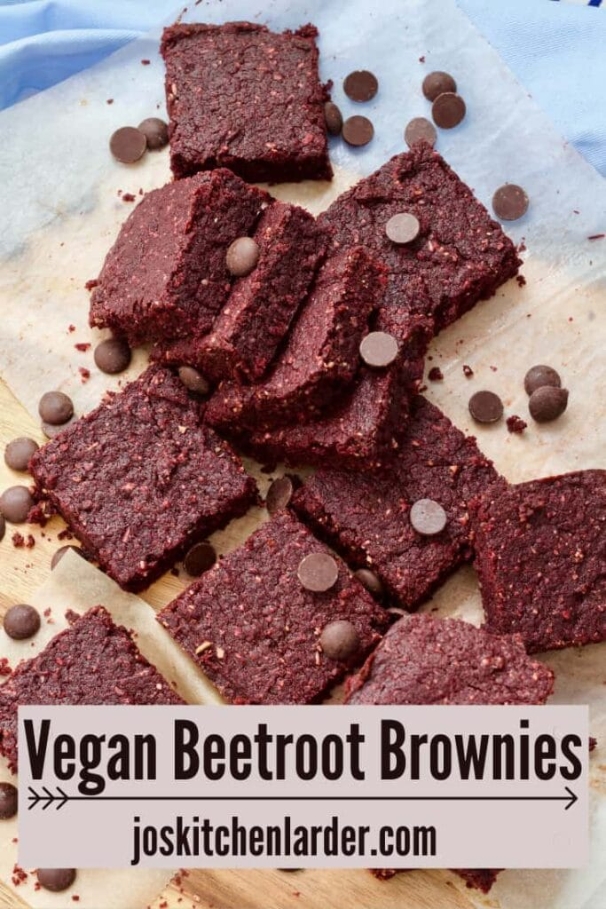 Squares of beetroot brownies with chocolate chips sprinkled over.