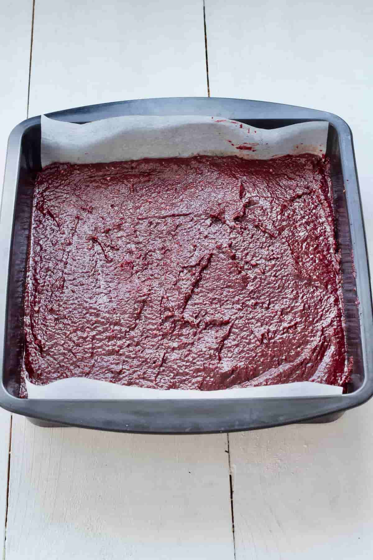 Vegan beetroot brownies in a tin before baking.